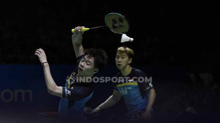 Ganda putra Indonesia, Kevin Sanjaya/Marcus Fernaldi berhasil mengalahkan perlawanan ganda Jepang Takuto Inoue/Yuki Kaneko dengan rubber set 20-22, 21-16 dan 21-14 pada babak pertama Indonesia Open 2019 di Istora Senayan, Selasa (16/07/19). - INDOSPORT