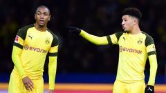 Indosport - Dua bintang Borussia Dortmund, Abdou Diallo (kiri) dan Jadon Sancho