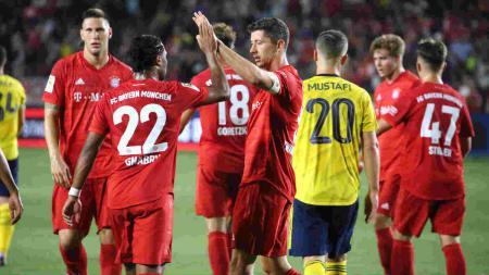 Pemain Bayern Munchen Berselebrasi Saat berhadapan dengan Arsenal - INDOSPORT