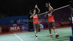 Indosport - Ganda putra Indonesia, Kevin Sanjaya Sukamuljo/Marcus Fernaldi Gideon berhasil mengalahkan wakil India lewat dua set langsung di babak kedua Indonesia Open 2019. Foto: Herry Ibrahim/INDOSPORT