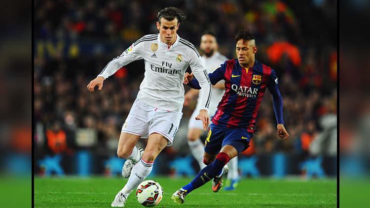 Gareth Bale (kiri) dan Neymar Jr pernah berjibaku di tahun 2015 lalu dalam laga bertajuk El Clasico Copyright: David Ramos/GettyImages