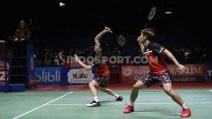Indosport - Kevin Sanjaya/Marcus Gideon sukses melaju ke babak perempatfinal China Open 2019 usai menang  atas pasangan Choi Solgyu/Seo Seung Jae.