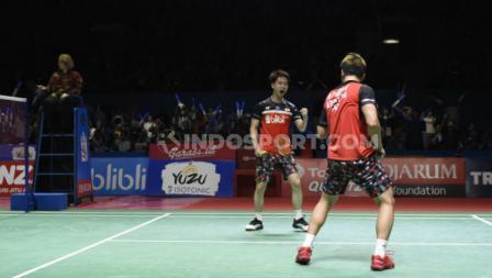 Ekspresi Kevin Sanjaya/Marcus Gideon saat selebrasi di laga semifinal Indonesia Open 2019.