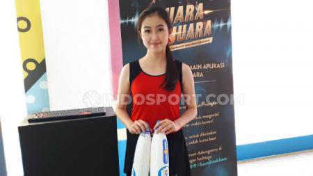 Tak hanya fasilitas yang memanjakan, hadirnya Sales Promotion Girl (SPG) di event ini juga menambah segar mata pengunjung Indonesia Open 2019. - INDOSPORT