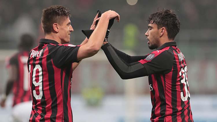 Dua bintang AC Milan saat ini, Krzysztof Piatek (kiri) dan Lucas Paqueta. Copyright: Emilio Andreoli/Getty Images