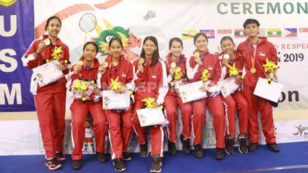 Kandaskan Malaysia, Indonesia berhasil mengawinkan medali emas bulu tangkis beregu Asean Schools Games (ASG) 2019. Foto: Zainal Hasan/INDOSPORT - INDOSPORT