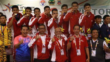 Kandaskan Malaysia, Indonesia berhasil mengawinkan medali emas bulutangkis beregu ASEAN Schools Games (ASG) 2019. Foto: Zainal Hasan/INDOSPORT - INDOSPORT