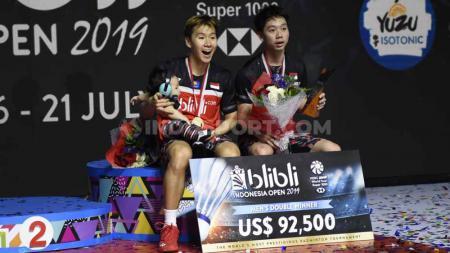 Kevin Sanjaya/Marcus Gideon masih berada di peringkat kedua dalam peringkat kualifikasi Olimpiade 2020. Foto: Herry Ibrahim/INDOSPORT - INDOSPORT