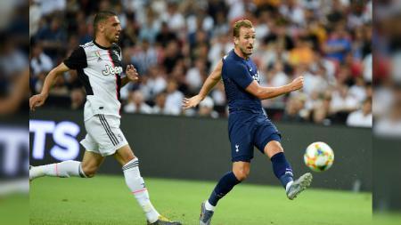 Harry Kane tampil berlaga membela Tottenham dalam laga ICC 2019 kontra Juventus. - INDOSPORT