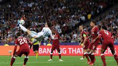 Indosport - Bintang Real Madrid Gareth Bale, mengisi waktu luang akibat isolasi mandiri dengan mengenang momen ketika ia jadi pahlawan di final Liga Champions 2 tahun lalu.