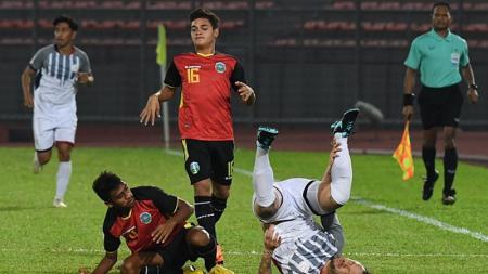 Striker Timor Leste, Paulo Domingos Gali Da Costa Freitas (tengah), dituding melakukan pencurian umur di ajang Piala AFF U-15 2019. - INDOSPORT