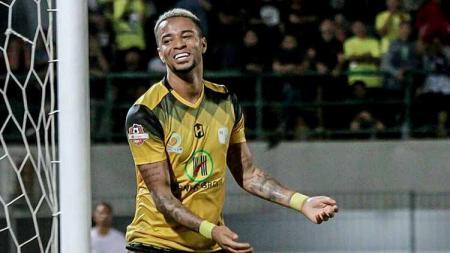 Selebrasi gol striker Barito Putera, Rafael Da Silva. - INDOSPORT