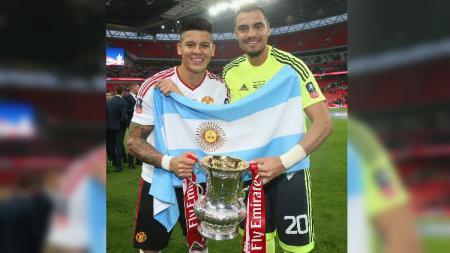 Tak diberi kesempatan, bek Manchester United, Marcos Rojo, ingin pindah klub. - INDOSPORT