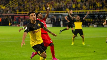 Aksi pemain Borussia Dortmund, Jadon Sancho usai cetak gol ke gawang Bayern Munchen di Piala Super Jerman, Minggu (04/08/19) - INDOSPORT