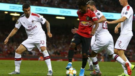 Jalannya pertandingan antara Manchester United vs AC Milan. - INDOSPORT