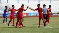 Indosport - Aksi selebrasi pemain Timnas Indonesia U-15.