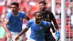 Raheem Sterling  melakukan selebrasi usai membobol gawang Liverpool. Laurence Griffiths/Getty Images