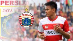 Indosport - Pemain Madura United Fachrudin Aryanto resmi ke Persija Jakarta. Foto: penawarta.com