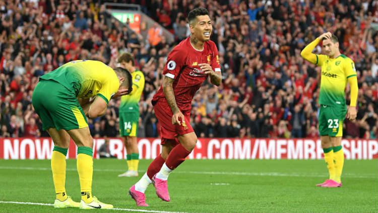 Roberto Firmino saat melakukan selebrasi di laga melawan Norwich City, Sabtu (10/08/19) dini hari WIB. Michael Regan/Getty Images Copyright: Michael Regan/Getty Images