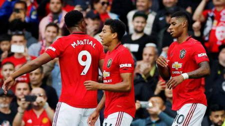 Martial, Jesse Lingard, dan Rashford melakukan selebrasi usai mencetak gol untuk Manchester United. - INDOSPORT