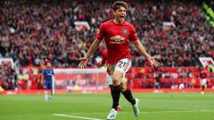 Indosport - Bintang Manchester United, Daniel James, mengalami insiden horor di laga Kualifikasi Euro 2020 Wales vs Kroasia. Matthew Ashton - AMA/Getty Images.