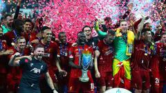 Indosport - Kegembiraan Liverpool melakukan selebrasi juara Piala Super Eropa setelah menaklukan Chelsea adu penalti. Kamis, (15/08/19) Istanbul, Turkey. Chris Brunskill/Fantasista/Getty Images