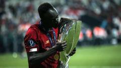 Indosport - Liverpool ingin Sadio Mane bertahan lama di Anfield. Sebnem Coskun/Anadolu Agency/Getty Images