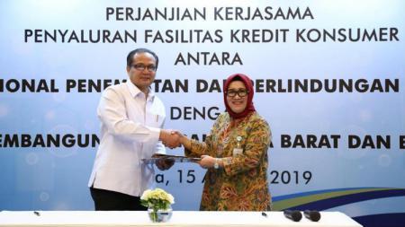 Bank bjb melaksanakan penandatanganan perjanjian kerja sama (PKS) penyaluran Kredit Konsumer dengan Badan Nasional Penempatan & Perlindungan Tenaga Kerja Indonesia (BNP2TKI). - INDOSPORT
