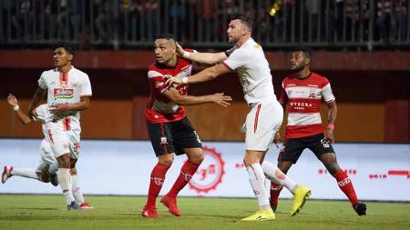 Laga pertandingan antara Madura United vs Persija Jakarta, Jumat (16/08/19). - INDOSPORT