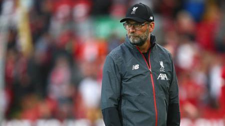 Pelatih Liverpool, Jurgen Klopp, menganggap anak asuhnya, Virgil van Dijk, layak dapat Ballon d'Or usai menjuarai Liga Champions. - INDOSPORT