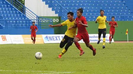 Malaysia benar-benar bertekad ingin menjadi pendamping Timnas Indonesia di ajang bergengsi Piala Dunia U-20 2021 mendatang. - INDOSPORT