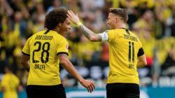 Selebrasi kemenangan dari Axel Witsel dan Marco Reus dalam laga Borussia Dortmund vs Augsburg