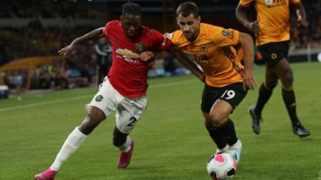 Aaron Wan-Bissaka berhasil mencatat rekor di Liga Inggris musim 2019-2020 saat Manchester United menaklukan Norwich City - INDOSPORT