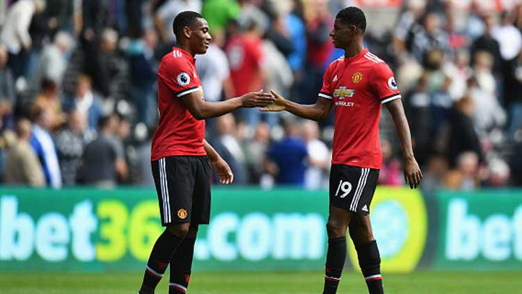Anthony Martial (kiri) dan Marcus Rashford, dua penyerang Manchester United Copyright: Dan Mullan/Getty Images