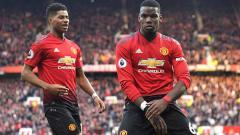 Indosport - Marcus Rashford (kiri) dan Paul Pogba, dua bintang Manchester United