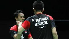 Indosport - Hendra Setiawan dan Mohammad Ahsan memastikan diri lolos ke perempatfinal Kejuaraan Dunia 2019.