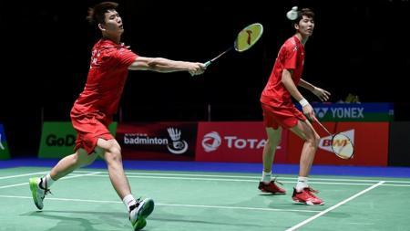 Pasangan ganda putra andalan China, Li Junhui/Liu Yuchen, lagi-lagi belum berhasil keluar dari 'kutukan' di Kejuaraan Dunia Bulu Tangkis 2019. - INDOSPORT