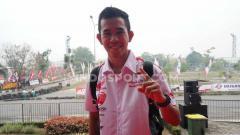Indosport - Gerry Salim, pembalap Moto2 FIM CEV, yang juga fans klub Persebaya Surabaya.