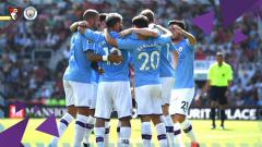 Indosport - Skuat Manchester City merayakan gol ke gawang Bournemouth, Minggu (25/08/19).