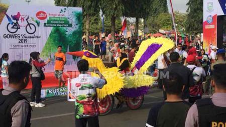 Semarak peserta Gowes Nusantara 2019 di Purbalingga. - INDOSPORT