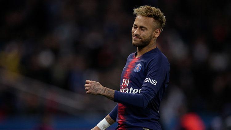 Ekspresi sedih dari pemain megabintang PSG, Neymar Copyright: Soccrates Images/Getty Images