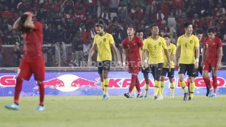 Berikut hitung-hitungan Timnas Indonesia bisa salip Malaysia di klasemen sementara Grup G Kualifikasi Piala Dunia 2022 zona Asia. - INDOSPORT