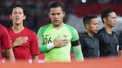 Indosport - Kiper Timnas Indonesia, Andritany Ardhiyasa saat mengheningkan cipta bersama Timnas.