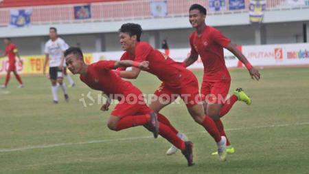 Gelandang Timnas U-22, Sani Rizki Fauzi berselebrasi usai mencetak gol ke gawang Bali United. - INDOSPORT