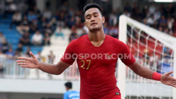 Striker Timnas U-22, Muhammad Rafli berselebrasi usai mencetak gol ke gawang PSIM Yogyakarta. Copyright: Ronald Seger Prabowo/INDOSPORT
