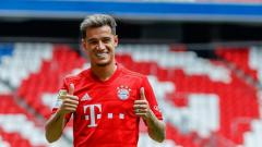 Indosport - Philippe Coutinho ketika berseragam Bayern Munchen. TF-Images/Getty Images.