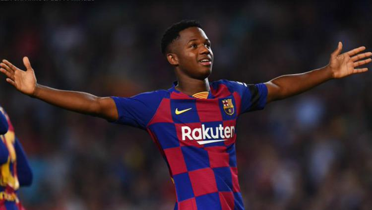 Ansu Fati mencetak gol di laga Barcelona vs Valencia, Minggu (15/09/19) dini hari WIB, di Camp Nou. Copyright: Alex Caparros/Getty Images