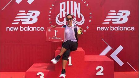 Triyaningsih, juara kategori 30-34 tahun New Balance Run On 2019 Minggu, 15 September 2019 di Qbig BSD City, Tangerang. - INDOSPORT