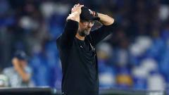 Indosport - Pelatih Liverpool, Jurgen Klopp meunjukan ekspresi yang tak mengenakkan usai timnya dikalahkan Napoli.