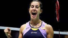 Indosport - Carolina Marin merayakan kemenangan di semifinal China Open 2019.